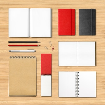 Stationery books and notebooks on a wooden surface