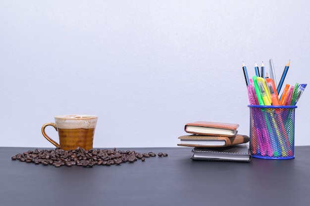 Stationery and coffee on the desk