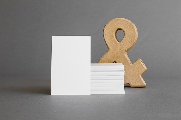 Stationery concept with business cards in front of ampersand