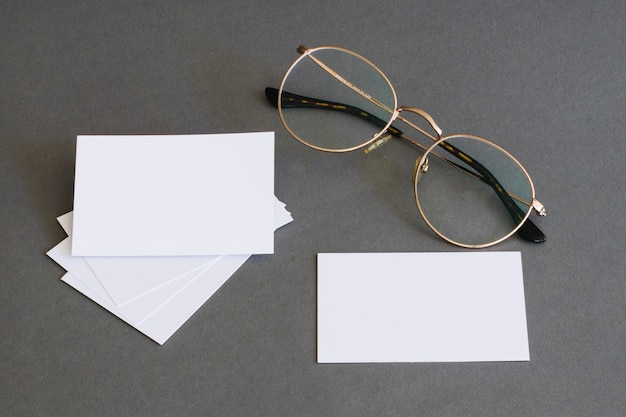 Stationery concept with business cards and glasses