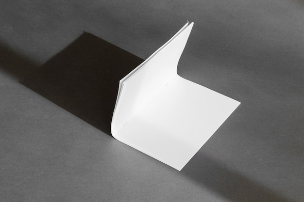 Stationery concept with folded paper sheet