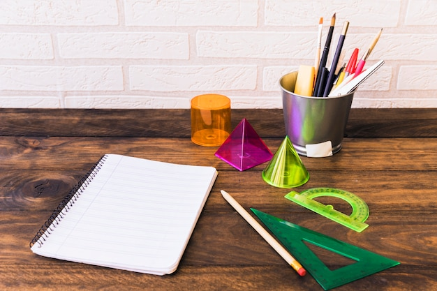 Stationery and geometric shapes on desk