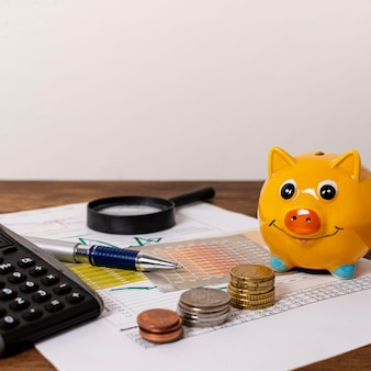 Stationery items and piggy bank with money