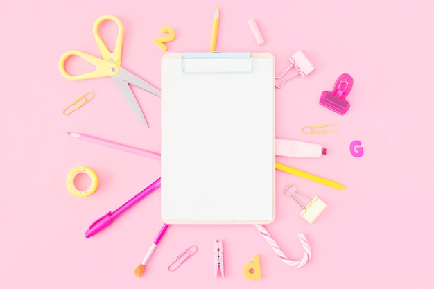 Stationery lying around clipboard