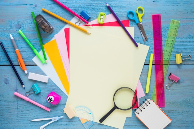Stationery and magnifying glass