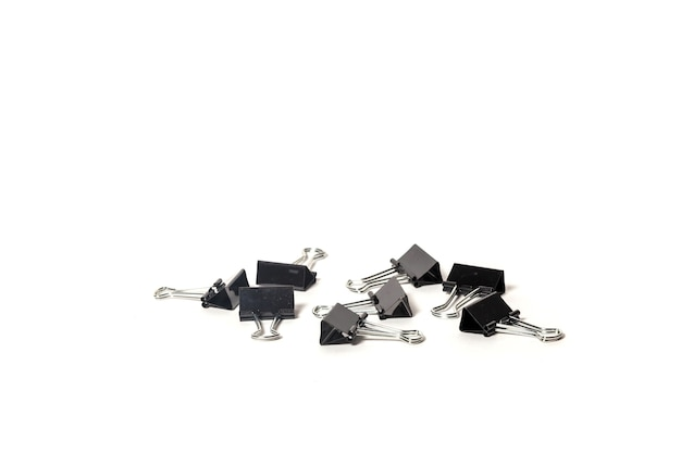 Stationery metal paper clip isolated. office folding clips scattered on desk. close-up of tool for clamping papers documents