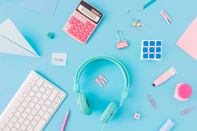 Stationery near assorted gadgets
