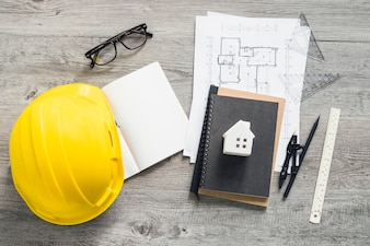 Stationery near hardhat and drafts