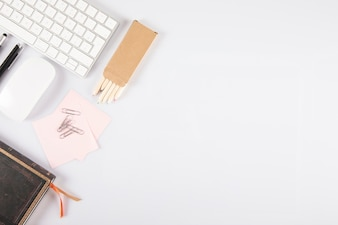 Stationery near keyboard and mouse