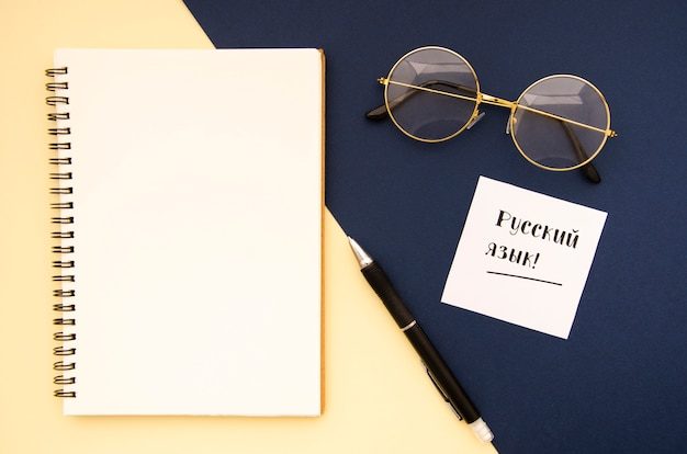 Stationery objects on bicolor background