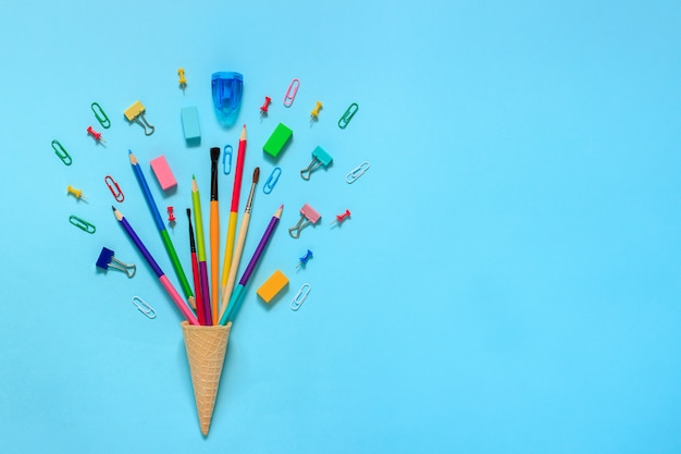 Stationery pencils paintbrush paperclip in waffle ice cream cone