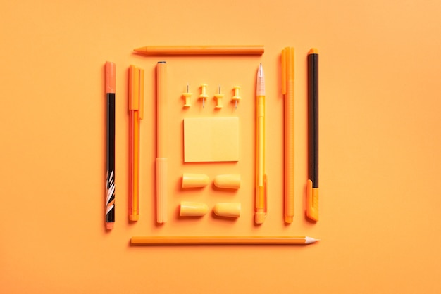 Stationery (for school or office) on a colored background. flat.