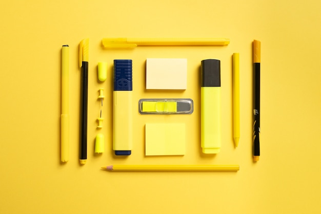 Stationery for school or office on a colored background.flat