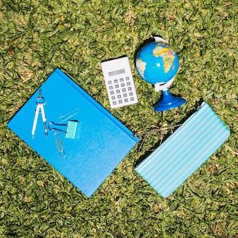 Stationery school set on grass