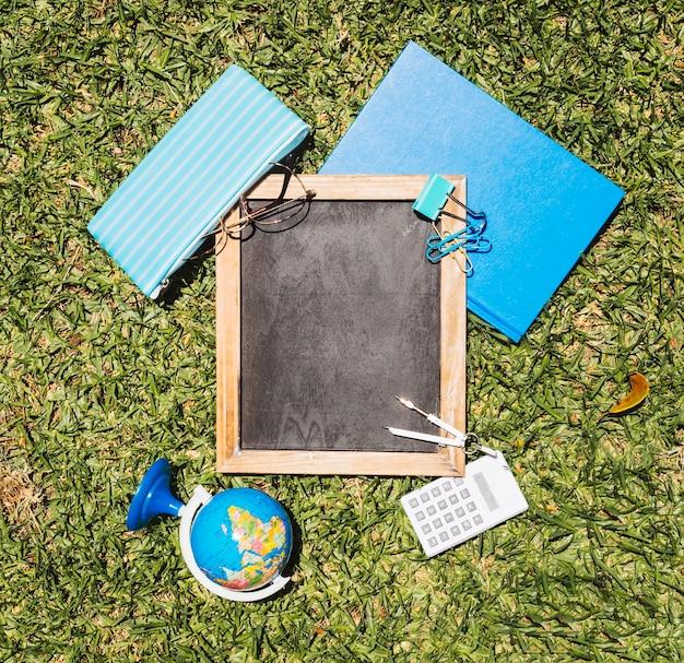 Stationery school set on green lawn