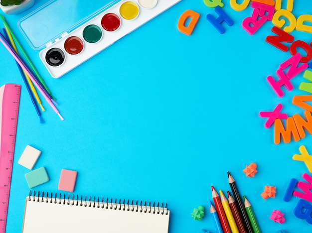 Stationery school supplies for creativity and learning on a blue background