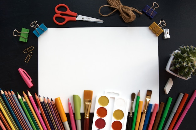 Stationery set and blank paper on black