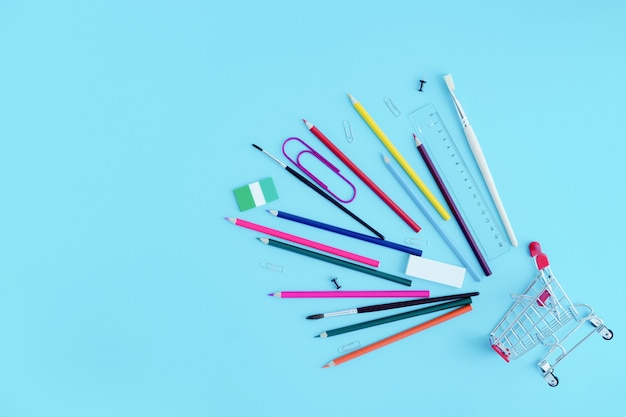 Stationery sprinkled from a shopping cart
