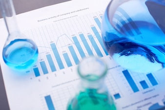 Statistical documents with test tubes