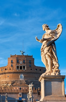 Statue of an angel on sant angelo bridge in rome, italy