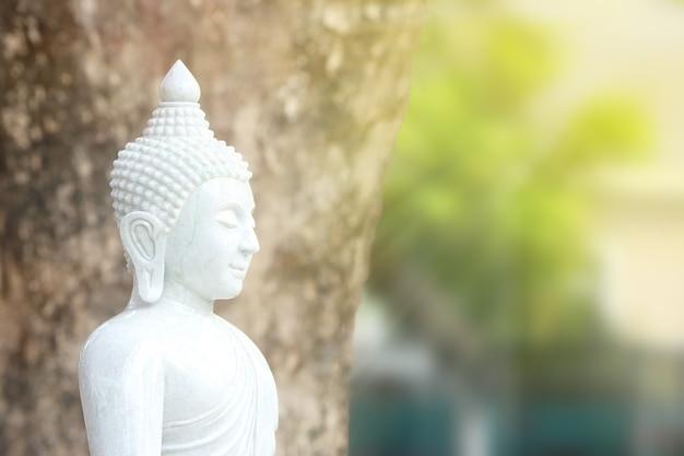 Statue of buddha made of white jade.