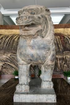 Statue of chinese guardian lion at shaanxi history museum, xi'an, shaanxi, china.