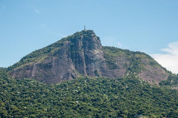 Statue of the christ the redeemer in rio de janeiro, brazil - february 14, 2021: statue of the christ the redeemer seen from rodrigo de freitas lagoon in rio de janeiro.