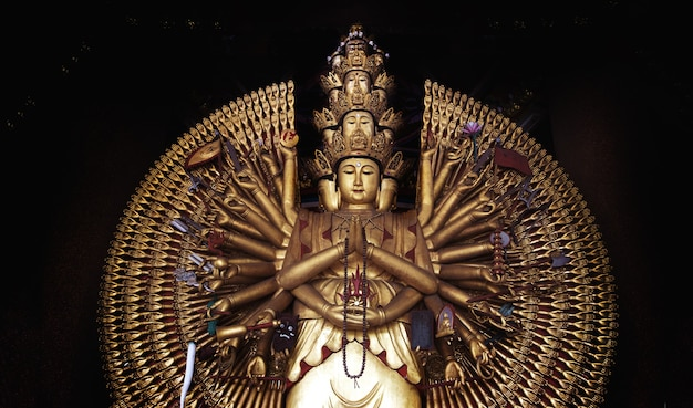 Statue of guanyin a thousand hands in a chinese temple