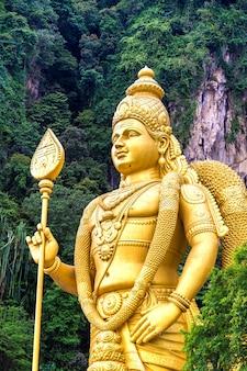 Statue of hindu god murugan at batu cave in kuala lumpur