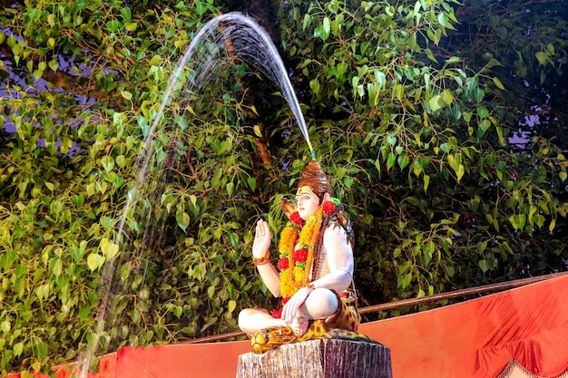 Statue of indian lord shankar coming out of the ganges from the hairs