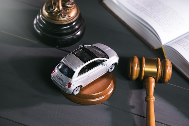 Statue of justice, gavel and car on wooden. trial