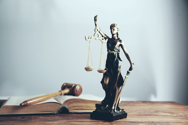 Statue of justice and wooden gavel