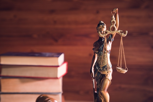 Statue of justice on wooden