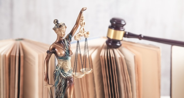 Statue of lady justice, gavel and books. legal and law