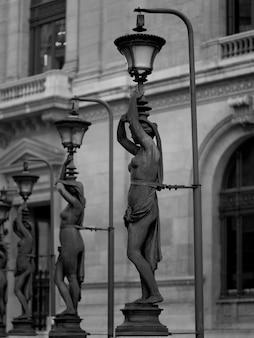 Statue lamp posts outside palais garnier in paris france