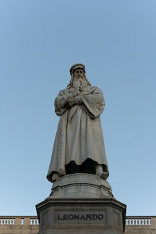 The statue of leonardo da vinci on clear blue sky
