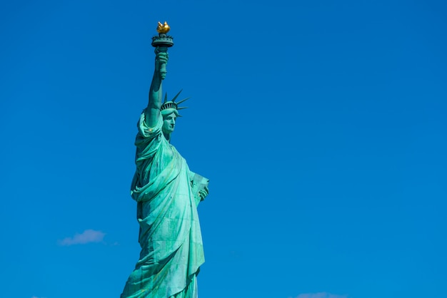 The statue of liberty under the blue sky background
