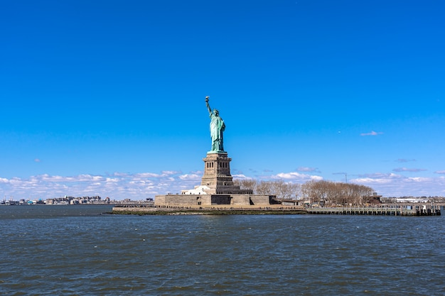 The statue of liberty under the blue sky