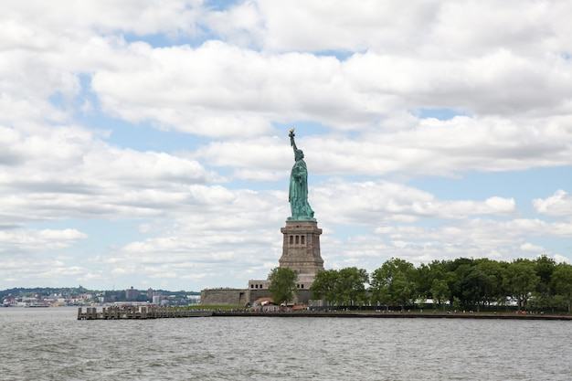 The statue of liberty look from beside  in new york ,usa