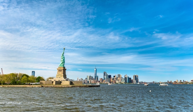 The statue of liberty and manhattan in new york city, usa