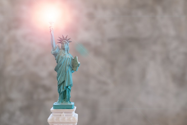 Statue of liberty with len flare effect on torch in the right hand
