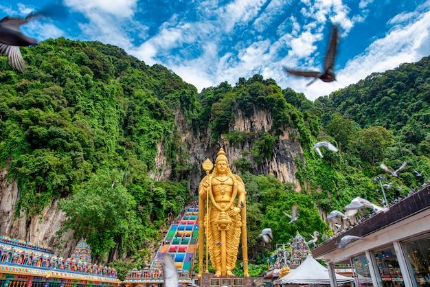 Statue of lord muragan and entrance at batu caves in kuala lumpur, malaysia.