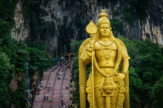 Statue of lord muragan and entrance at batu caves in kuala lumpur
