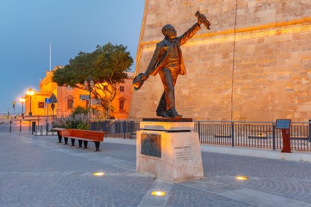 Statue of manwel dimech former maltese prime minister during blue hour, valletta, malta