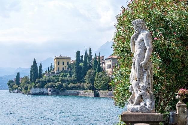 Statue on shore of lake como