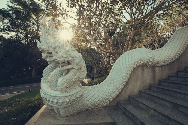 A statue of a thailand white serpent stairways  blue sky / king of nagas