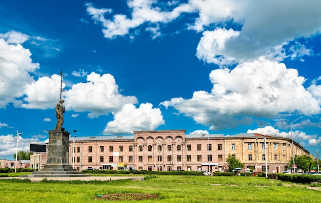 A statue and the university at independence square in gyumri, armenia
