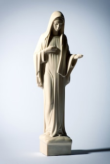Statue of the virgin mary on grey