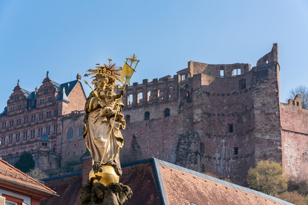 Statue of the virgin mary in the, heidelberg, germany with the heidelberg castle.