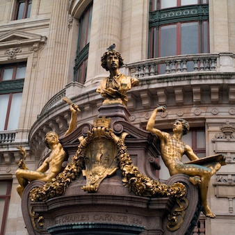 Statues adorning the palace garnier in paris france
